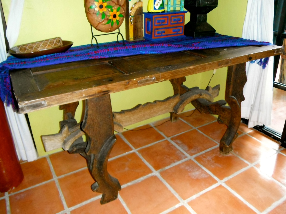 I really like this desk. Especially its legs; all hand carved. A glass top on the door that makes its surface would make it a perfect workstation.
