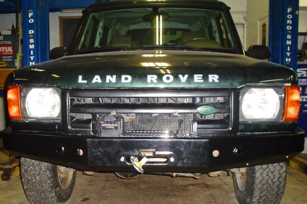 Bumper: Terrafirma TF009, Winch: Superwinch LP8500. Freshly installed on my 1999 Land Rover Discovery Series II. Note the winch protective grille (to be painted) my mechanic fashioned out of what was a brush guard for the fan and radiator area on the factory bumper. Clever.