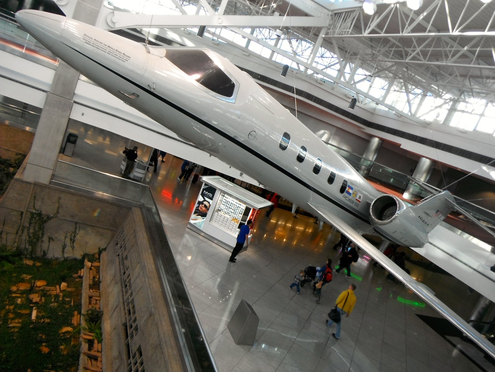 This plane holds the Official Around the World Speed Record at 49 hours 21 minutes. As seen hanging from the ceiling in concourse C at the Denver airport.